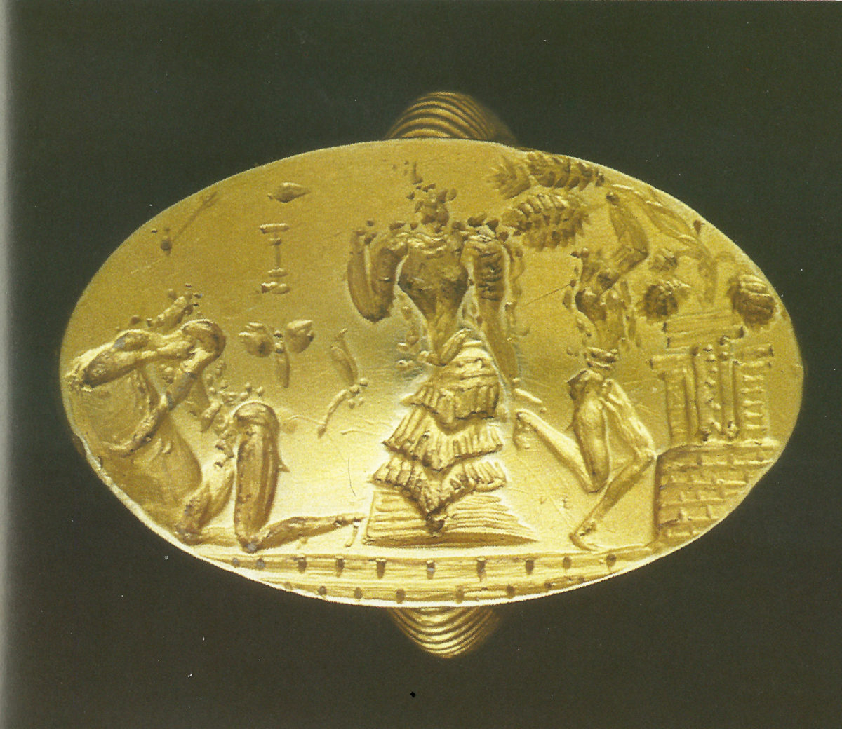 Fig. 35. The gold ring of Archanes. Found in the Fourni cemetery, placed on the deceased woman's breast. Late Bronze Age (1600-1500 B.C.). Archaeological Museum of Heraklion, AE 989.