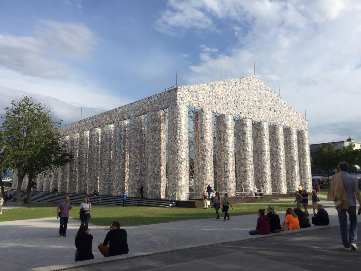 The Parthenon of Books (2017). Steel, books, and plastic sheeting. 19.5 × 29.5 × 65.5 m. Commissioned by documenta 14, with support from the Ministry of Media and Culture of Argentina. Friedrichsplatz, Kassel. Photo credit: K. Charatzopoulou