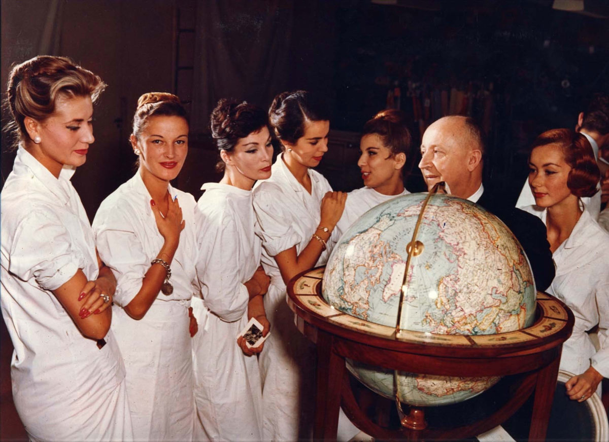 Christian Dior with his models, circa 1955 (photo: André Gandner.)