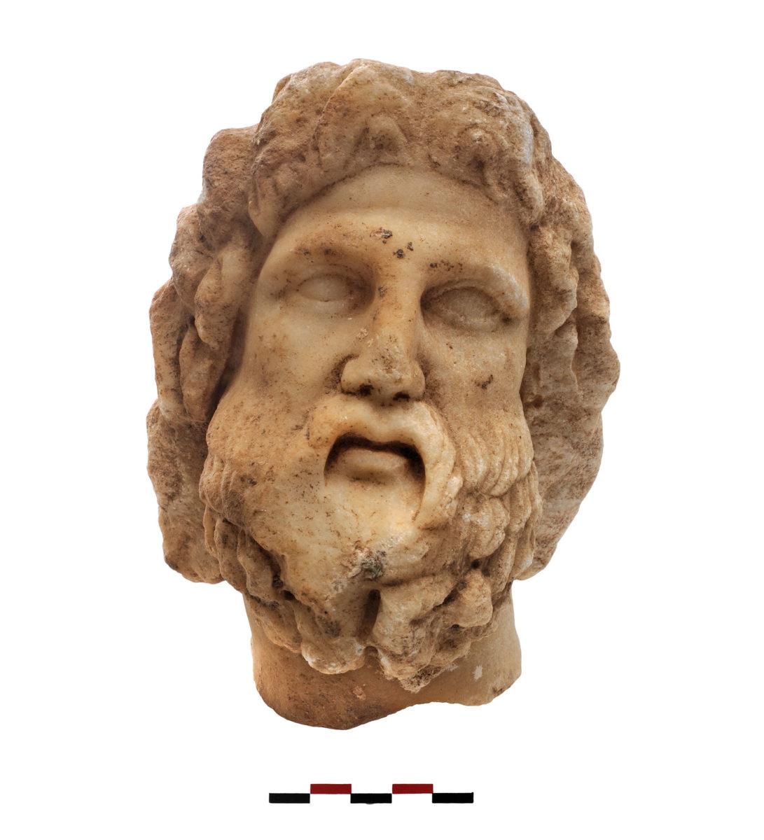 Fig. 11. Head of a bearded figure (Asclepius or Serapes). Photo Credit: Kostas Xenikakis.