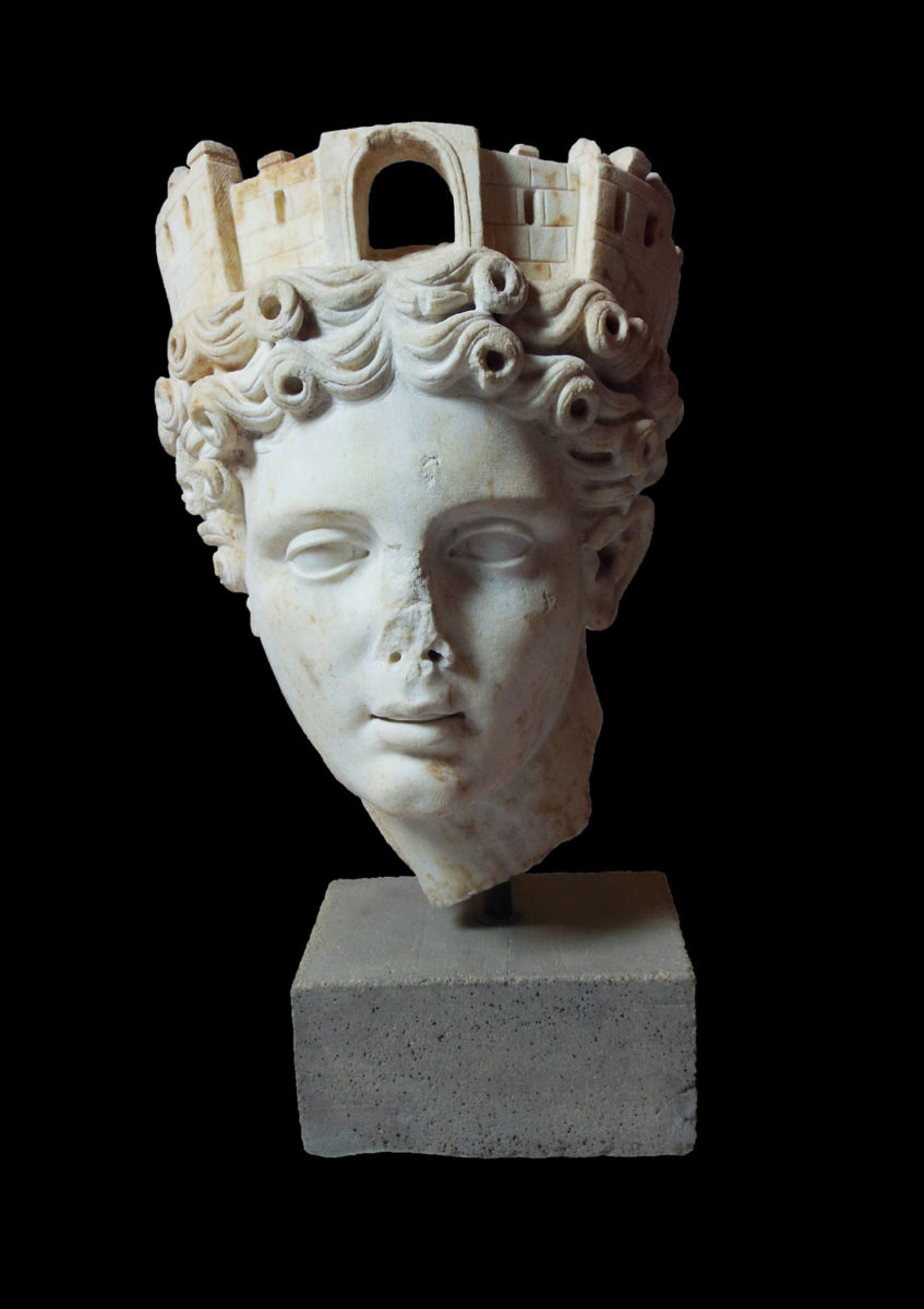Marble head of tower-crowned Tyche. End of 1st c. AD. © Archaeological Museum of Ancient Corinth (photographic archive of the Ephorate of Antiquities of Corinthia).