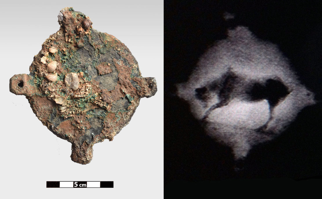 Bronze, disc like object with four perforated appendages, on which,as shown by radiography, there is the image of an animal, probably a bull (photo: Ministry of Culture and Sports)