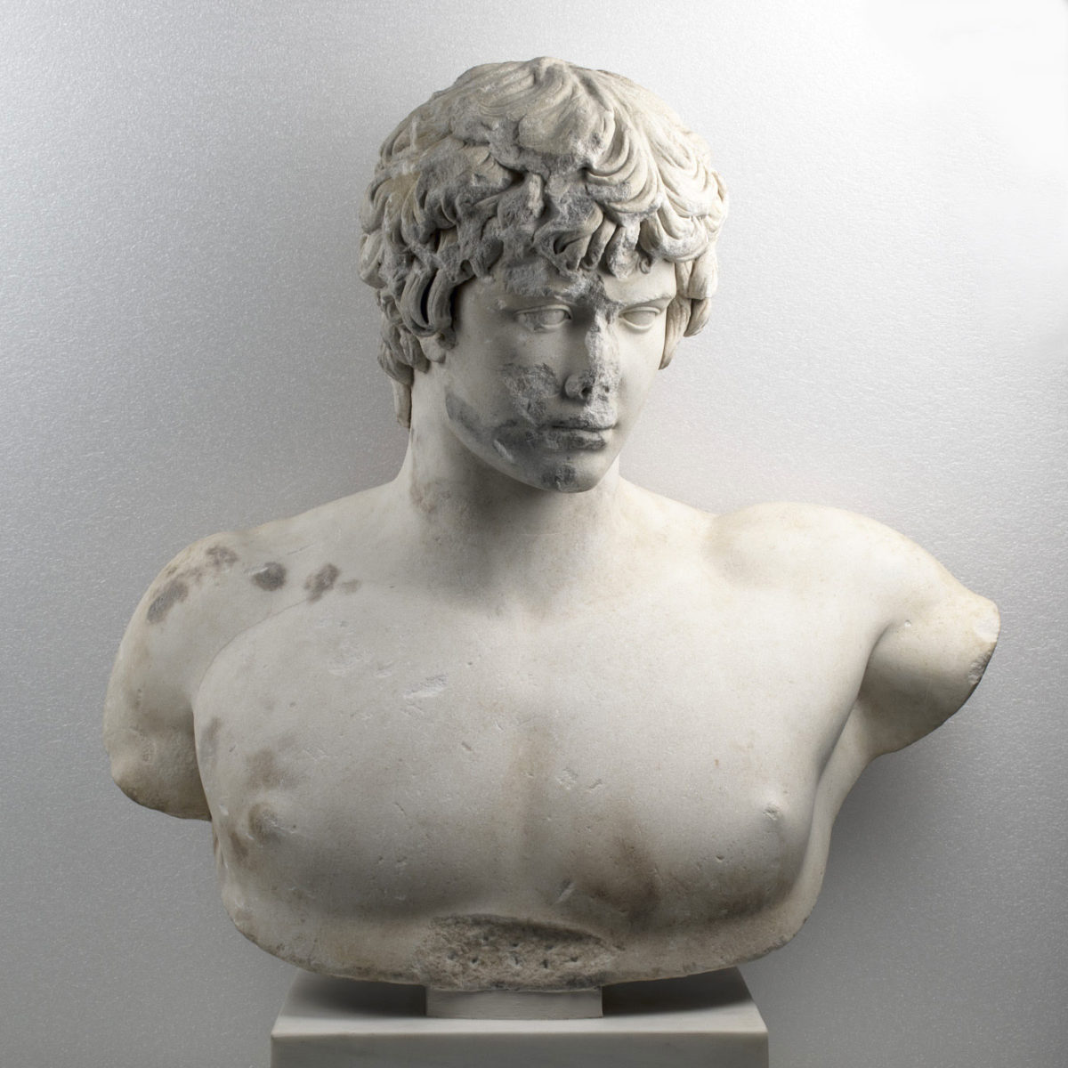 Nude bust with head of Antinous. Found in Patras in 1856. It dates from just before 130 AD. Exhibit number Γ 418 (Photographic Archive of the National Archaeological Museum)