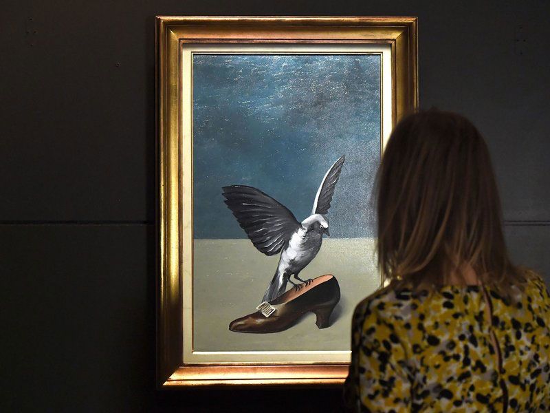 """Magritte's painting """"God is not a saint"""" painted over a part of the painting """"La Pose Enchantée"""". Photo: Emmanuel Dunand/AFP/Getty Images."""