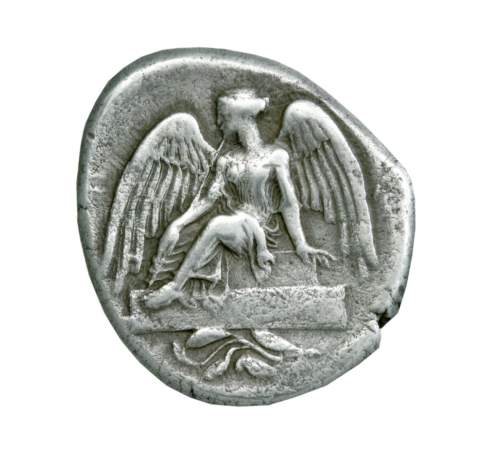 Silver stater of Elis depicting a winged Nike (Victory) seated on a pedestal. 432 – 421 BC © Athens, Alpha Bank Numismatic Collection (photo by P. Magoulas)