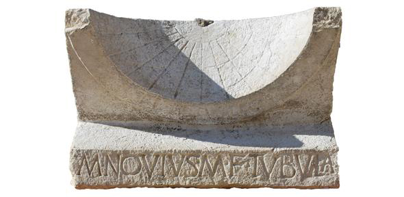 The sundial pictured after excavation. Credit: Alessandro Launaro