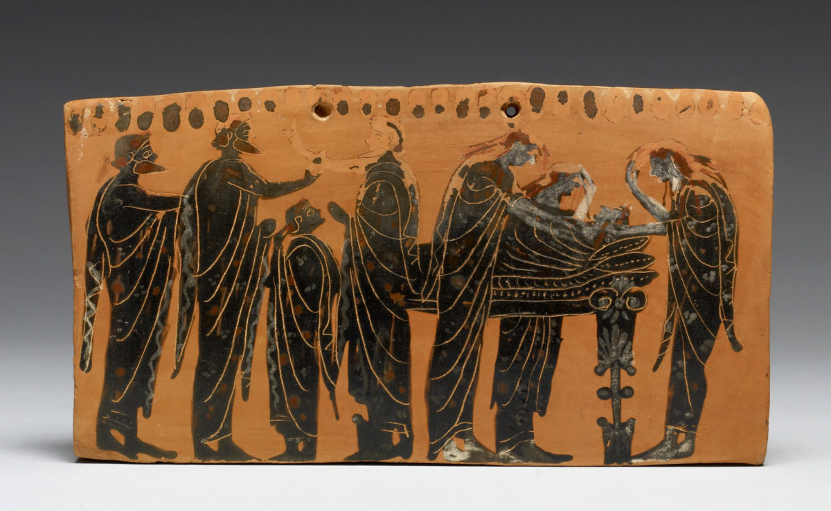 The lying in state of a body (prothesis) attended by family members, with the women ritually tearing their hair, depicted on a terracotta pinax by the Gela Painter, latter 6th century BC.
