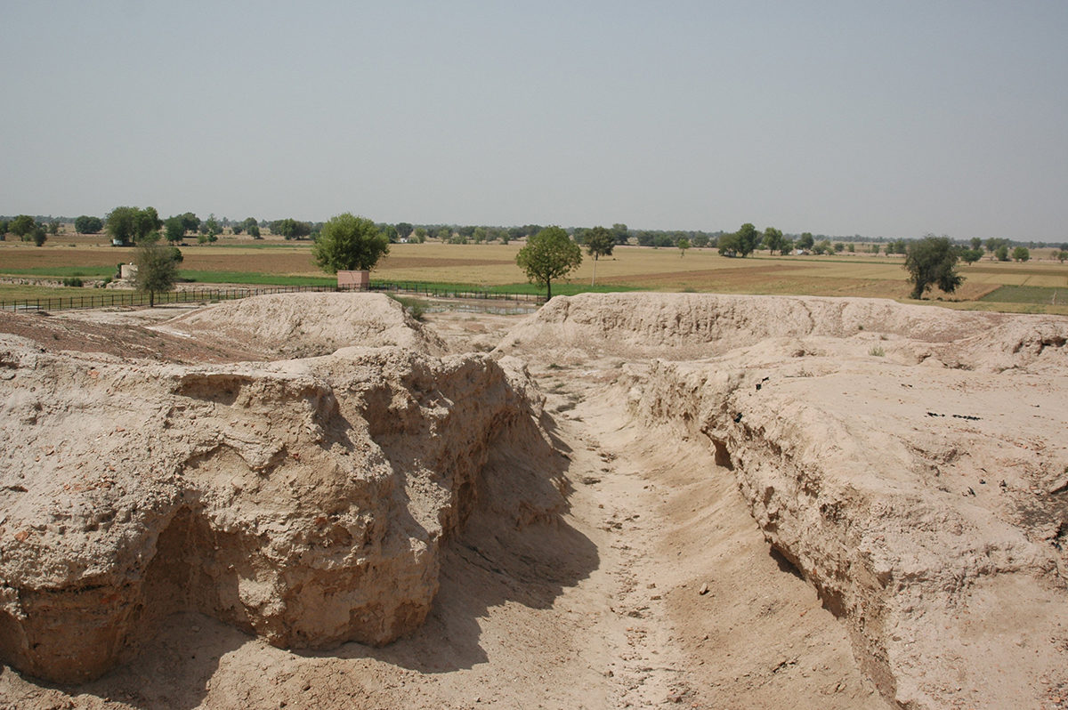 Remnant of a street in the urban centre of Kalibangan. The Ghaggar-Hakra palaeochannel can be seen in the distance. Kalibangan is sited on the topographically higher margins of the palaeochannel. Credit: S. Gupta (Imperial College London)