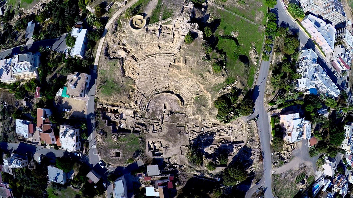 Fig. 1. Aerial view of the ancient theatre and the surrounding area with the nymphaeum and the paved road.