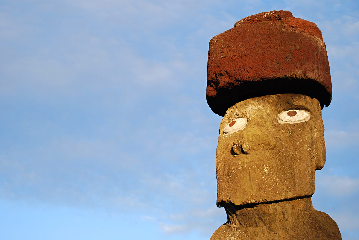 """One of the hats called """"pukao"""" which are cylindrical stones made from a volcanic rock known as 'red scoria.'"""