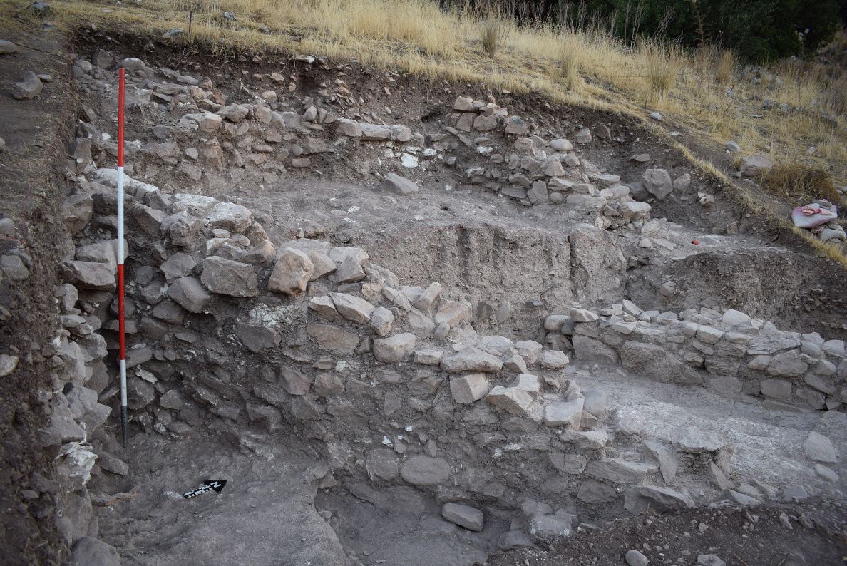 Area XI at Prasteio-Mesorotsos: in the foreground is the nearly 2 m. high intact Middle Bronze Age wall that would have stood at least two stories high in antiquity.