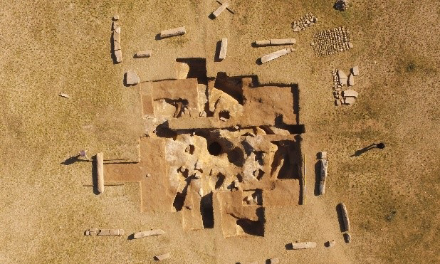 The monument itself is of a square configuration comprising of 14 stone pillars, surrounding a sarcophagus within the centre of a raised mound. Credit: Osaka University and Institute of History and Archaeology, Mongolian Academy of Science.