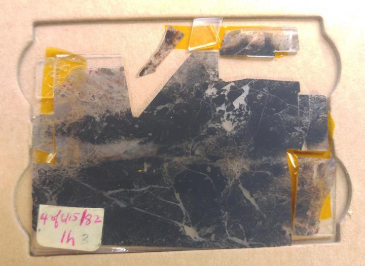 This sample of rock was taken from the Apex Chert, a rock formation in western Australia that is among the oldest and best-preserved rock deposits in the world, in 1982 and was soon found to contain evidence of early life on Earth. Credit:  Courtesy of John Valley, UW-Madison