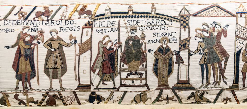 Bayeux tapestry scene: The coronation of Harold II; he receives orb and sceptre. Credit: Wikimedia Commons