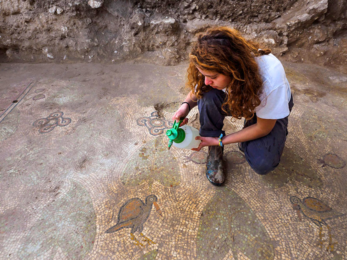 An archaeology student uncovering the mosaic floor of a church at Beth Shemesh, Israel. Image credit: Assaf Peretz, Israel Antiquities Authority.