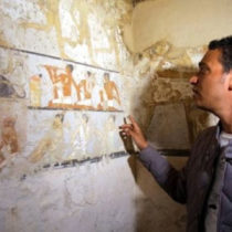 Archaeologists look inside the tomb of an ancient Egyptian priestess