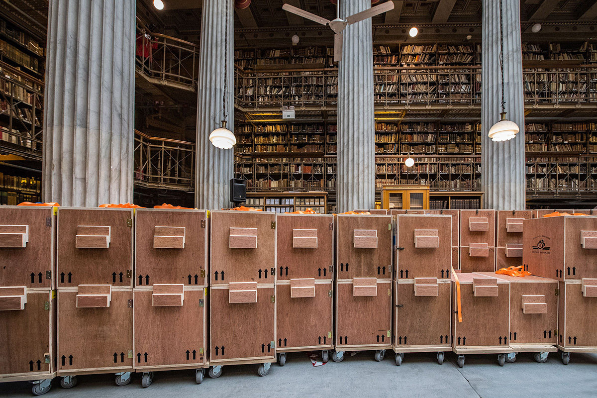 Wheeled bookcases in the main reading room of the Vallianeion.