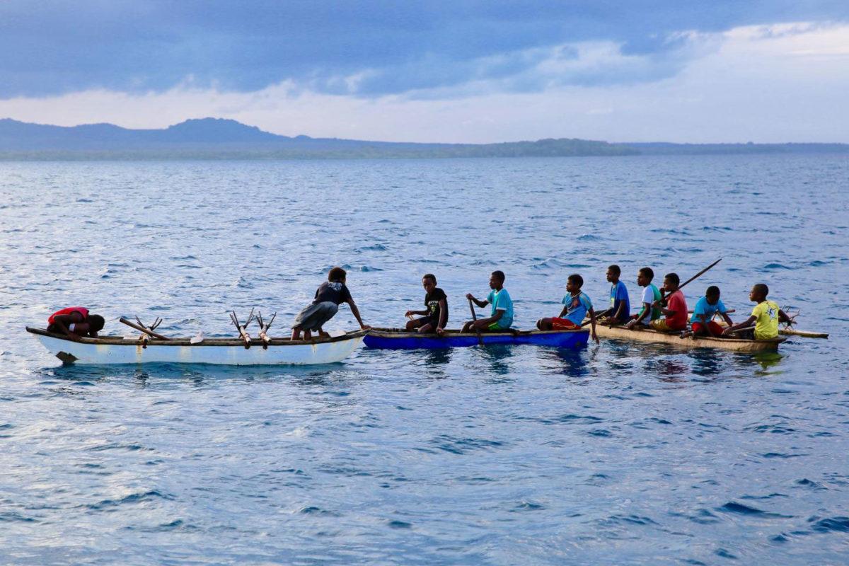 Young men in canoes in Northwest Malakula, Vanuatu. Credit: Russell Gray & Heidi Colleran
