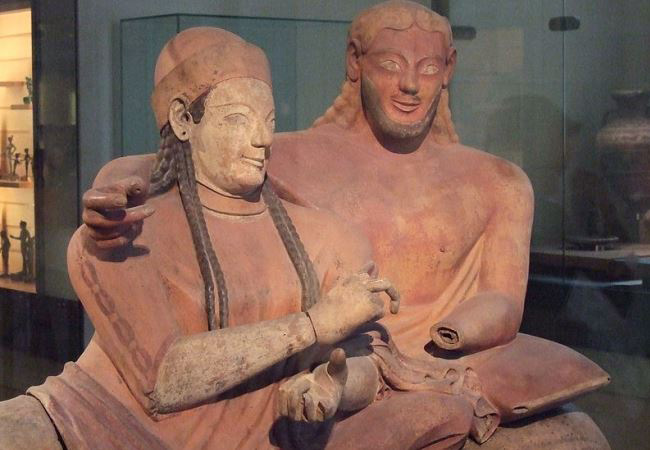 """Title: """"Couple reclining, ceramic burial sarcophagus, Cerveteri, Italy 520-510 BC. The Louvre"""" Author: Ecelan License: CC BY 2.5 Source: https://commons.wikimedia.org/w/index.php?curid=2068355"""