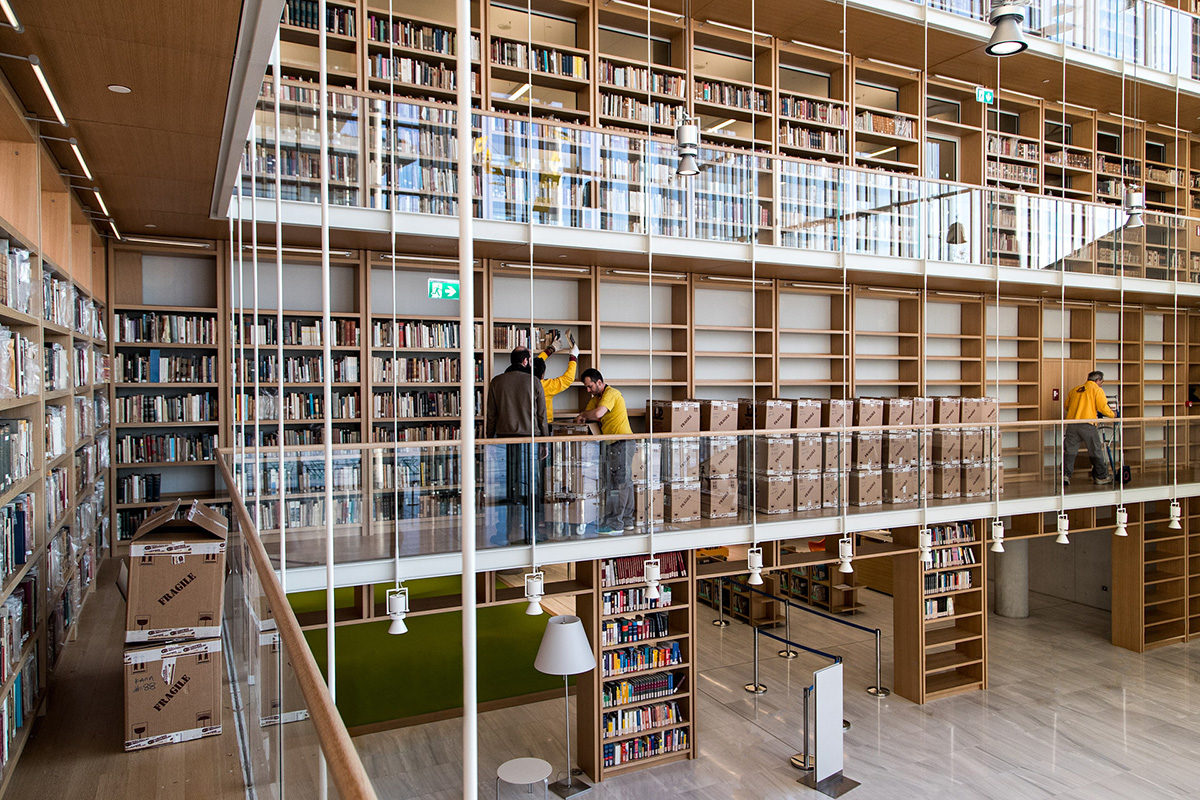 "Placing books on the book ""stacks"" of the National Library of Greece."