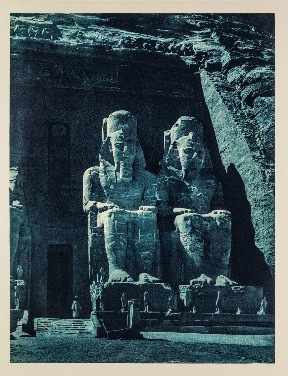 The statues of Ramesses II at the entrance of the Grand Temple to the archaeological site of Abu Simbel, photographed in the moonlight, Egypt 1929. From the book Égypte, published by Paul Trembley in Geneva (1932).