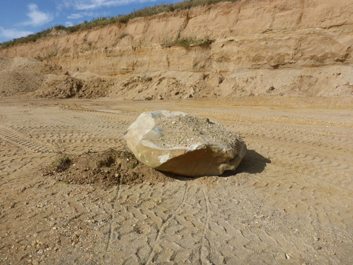 This boulder in the gravel pit Rehbach in Saxony, Germany, was transported from Scandinavia by glaciers 450,000 years ago. Credit: MPI f. Evolutionary Anthropology