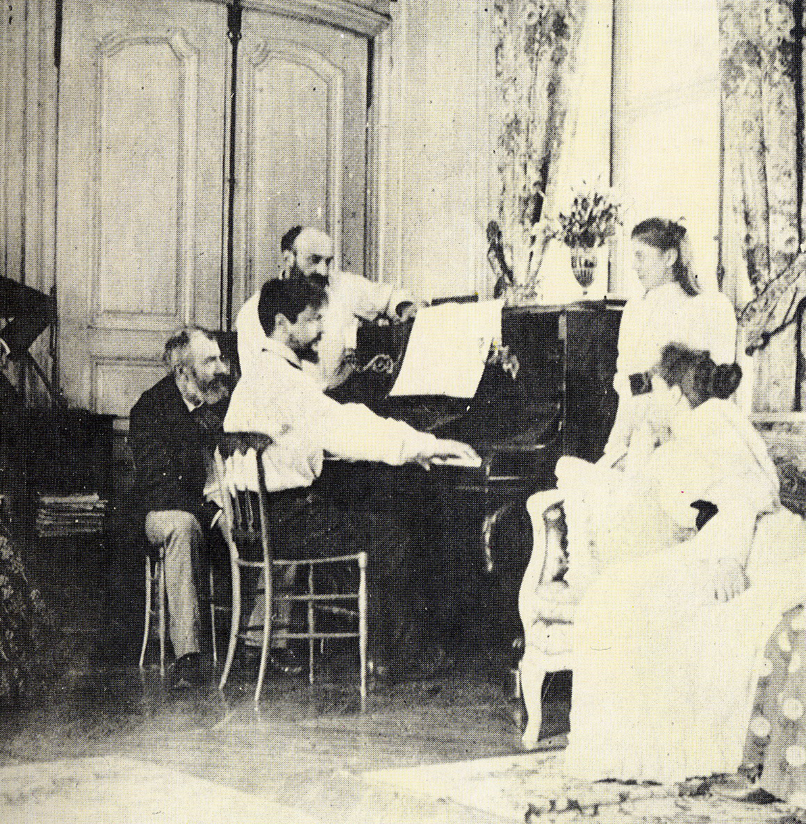 Claude Debussy at the piano in 1893.