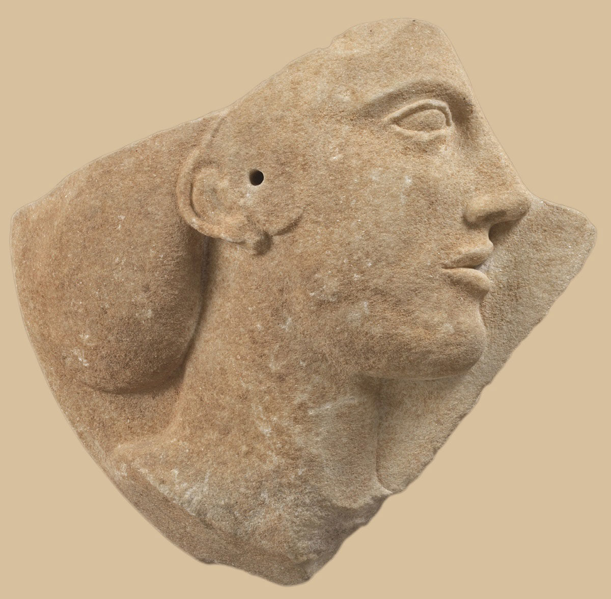 Part of marble disc with relief female head, probably Aphrodite. From Melos. Around 460-450 B.C. (photographer: Giannis Patrikianos) (© National Archaeological Museum/ Archaeological Receipts Fund