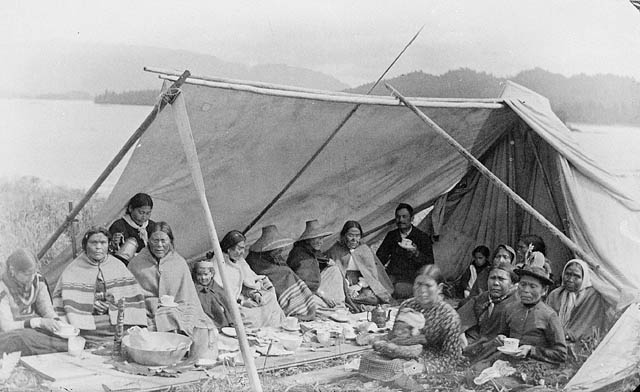 Members of the Tsimshian Native American tribe hold a tea party near Fort Simpson, British Columbia, in 1889.  Credit: Library and Archives Canada