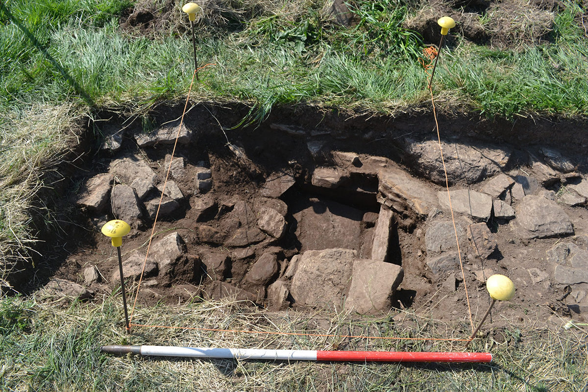 Stone lined hearth emerging from the rubble, Thusater Burn Dig- Credit: Orkney Research Centre for Archaeology