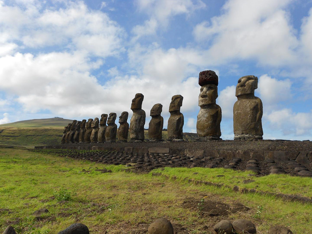 This is a restored statue platform with standing moai on the south coast of Rapa Nui. Note that one of the moai is adorned with a red scoria pukao. Credit: Sean Hixon