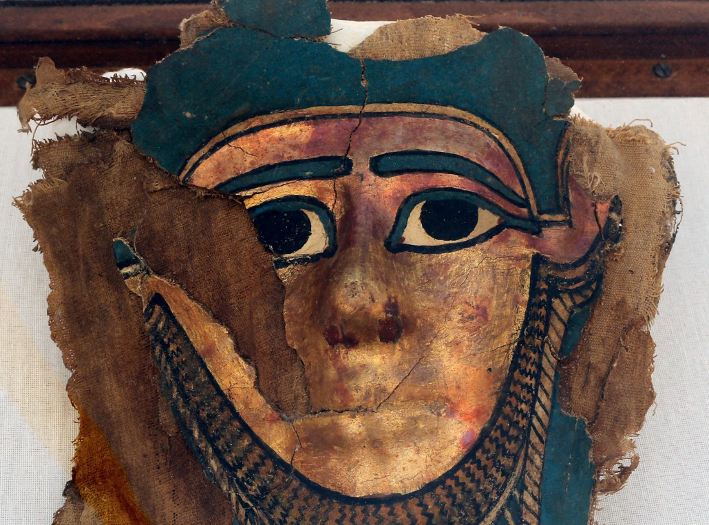 A recently discovered gilded mummy mask is displayed after it was found in a disturbed context  of the hall way of a burial chamber dating back some 2,500 years at the ancient necropolis  near Egypt's famed pyramids in Saqqara. Credit: Amr Nabil/AP