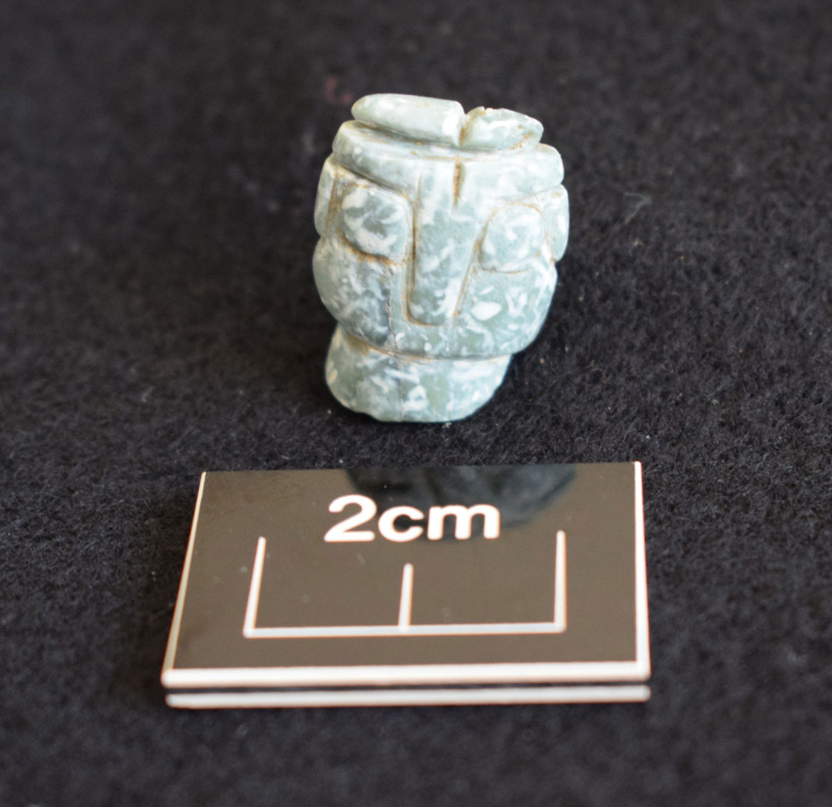 Fragment of a picrolite figurine, carved in the typical Middle Chalcolithic style. (Photo: Department of Antiquities of Cyprus)