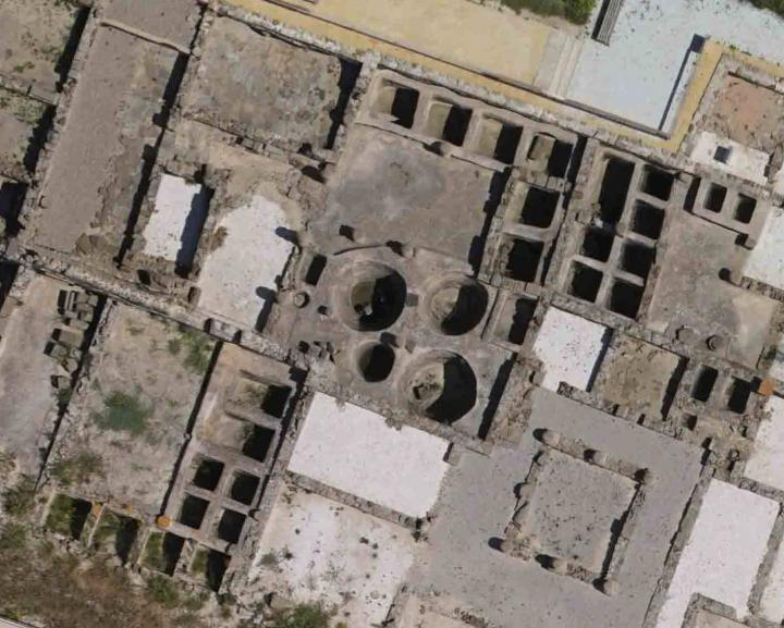 Aerial view of some of the fish-salting tanks (cetaria) in the ancient Roman city of Baelo Claudia, near today's Tarifa in Spain. The largest circular tank is 3 meters wide, with a 18m3 capacity. These tanks were used to process large fish, particularly tuna. This study supports the possibility that they could have also been used to process whales. Credit: D. Bernal-Casasola, University of Cadiz