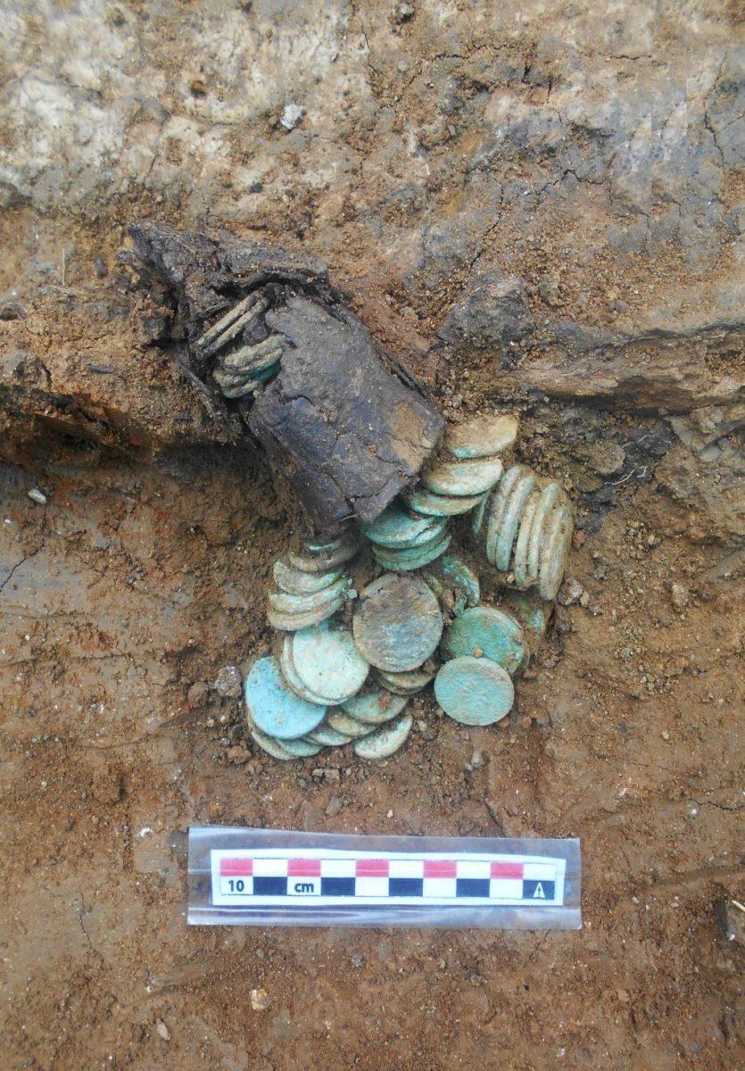 Theodosia, bronze coins as grave goods.