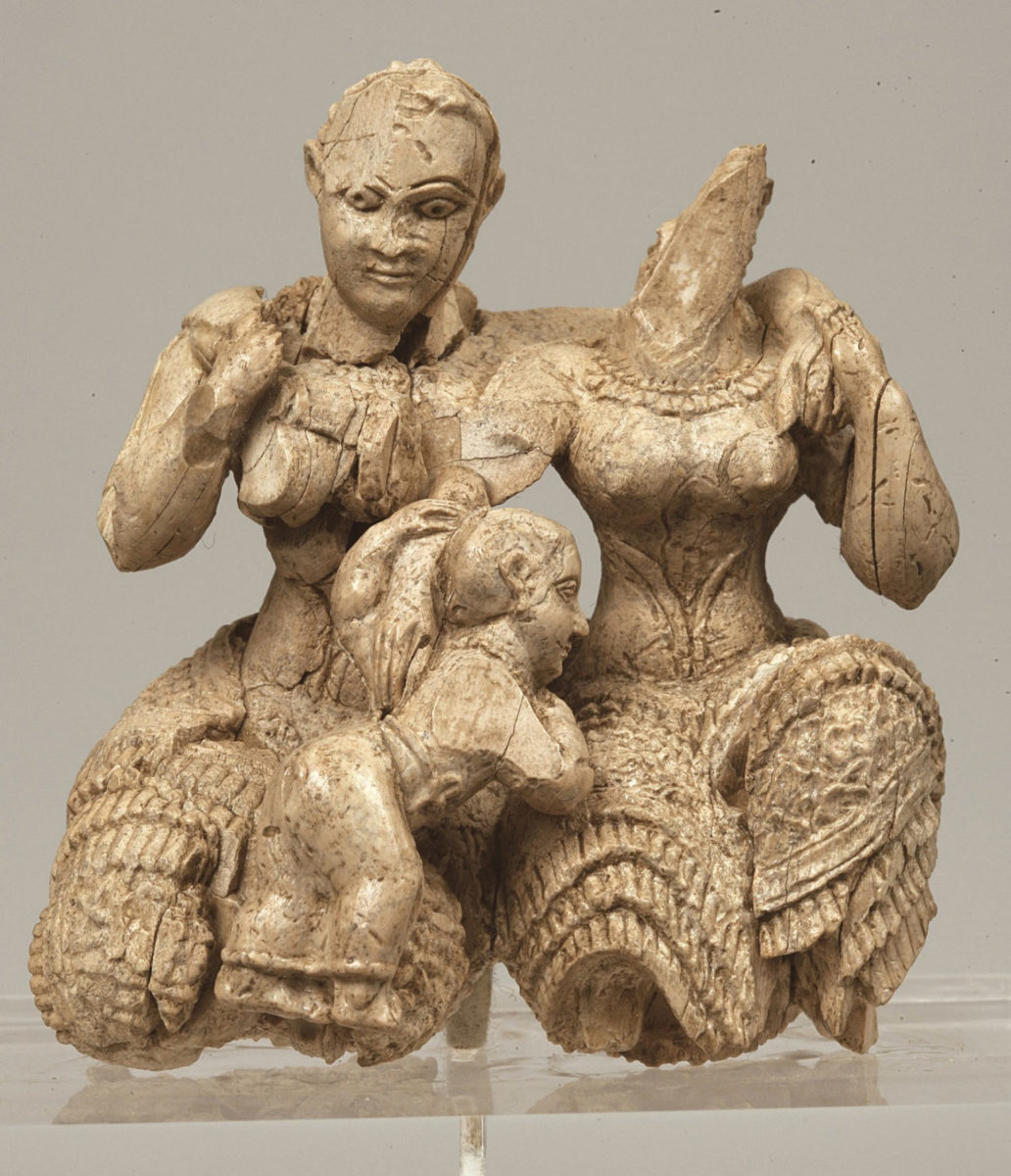 "Ivory sculptural composition of two seated female figures and a child, known as the ""Ivory Triad″. Inv. Nr. ΕΑΜ Π 7711, Acropolis of Mycenae, palace area, 15th-14th c. BC. © National Archaeological Museum / Fund of Archaeological Proceeds."