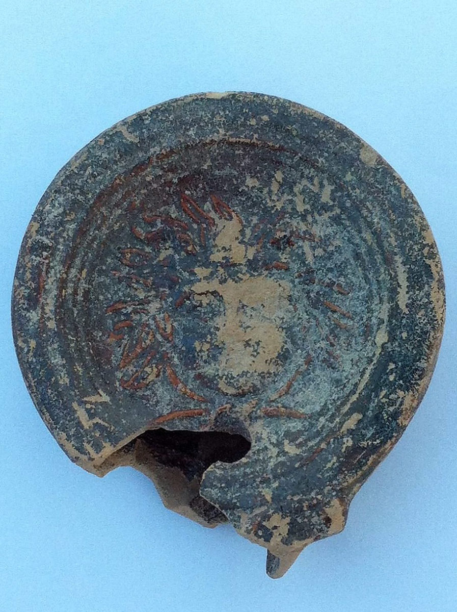 Pafos-Toumballos: Among these finds a lamp adorned with a head with wavy hair is worth mentioning.