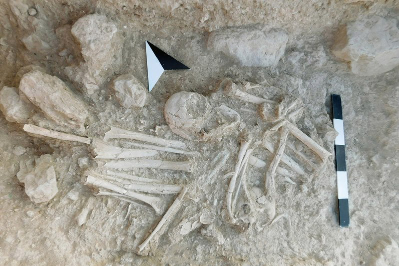 Secondary burials in Funerary Building 27. The bones have been neatly transferred from the primary burial place (obviously in baskets).