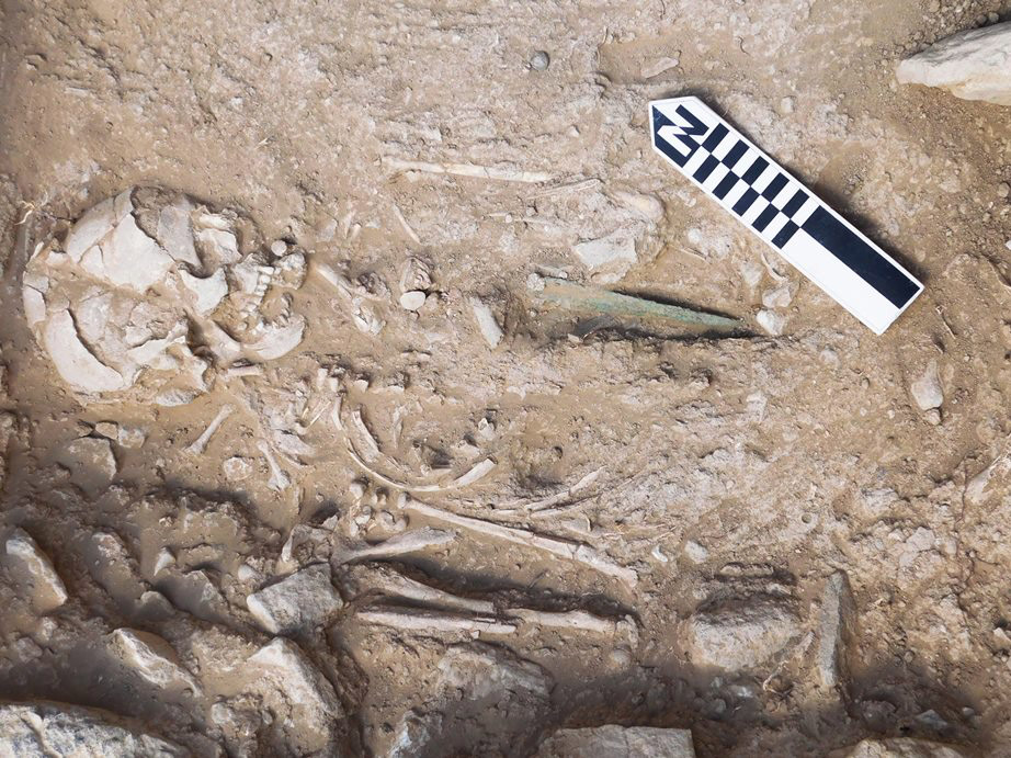 Middle Minoan IA primary pit burial of a man, with a bronze dagger (under Funerary Building 2).