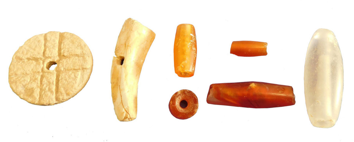 Middle Minoan IA beads of various types: ivory, carnelian and rock crystal.