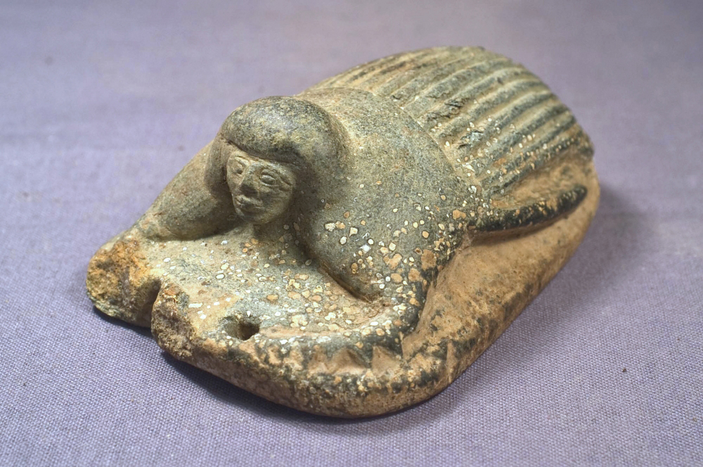 This heart scarab from the tomb of a woman named Weret, was inscribed with a spell from the Book of the Dead that  prevented a person's heart from testifying against them in the divine judgement. A scarab with a person's  head is rarer than the purely insect type. Credit: Elizabeth Drolet/UCSB.