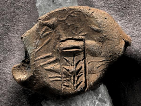 Linear B label (nodule) with seal impression from Pylos. Credit: University of Colorado Boulder