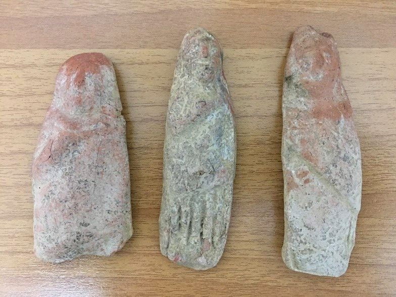 Three terracotta female statuettes confiscated in Sparta (photo: Hellenic Police).
