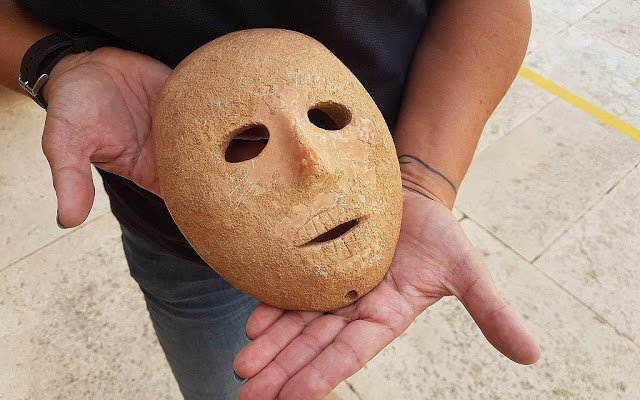 The rare stone mask dates to the Neolithic period. Credit: Clara Amit/Israel Antiquities Authority