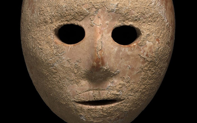The 9,000-year-old stone mask discovered in the southern Hebron Hills area of the West Bank in early 2018. Credit: Antiquities Theft Prevention Unit/Israel Antiquities Authority]