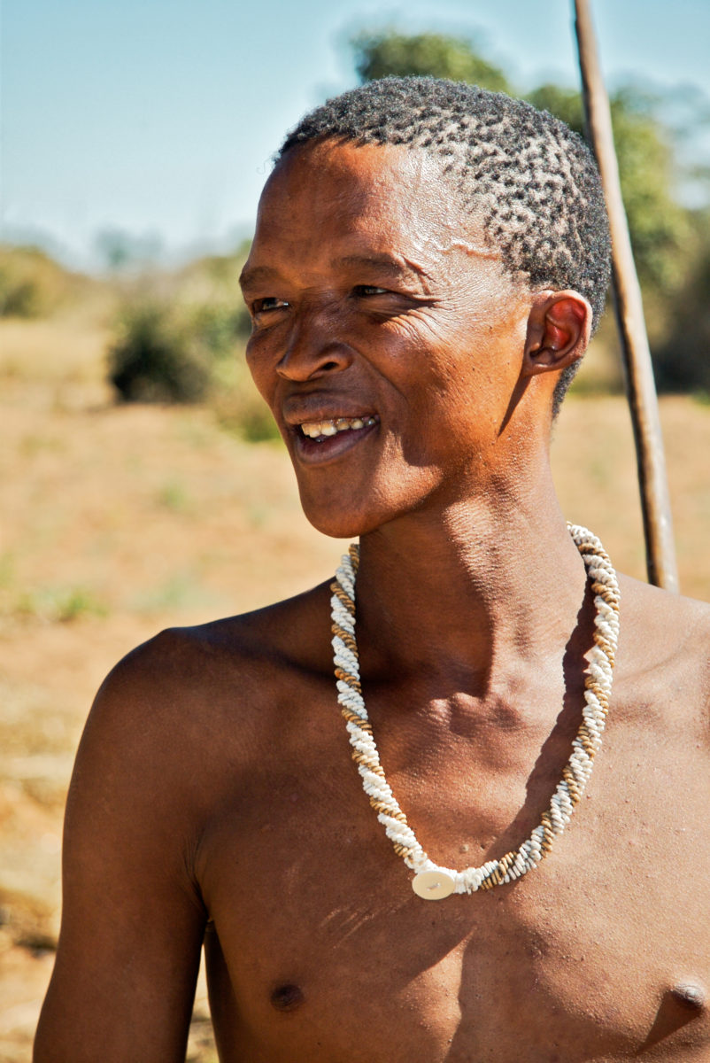 A San (Bushman) who gave us an exhibition of traditional dress and hunting/foraging behavior. Namibia.