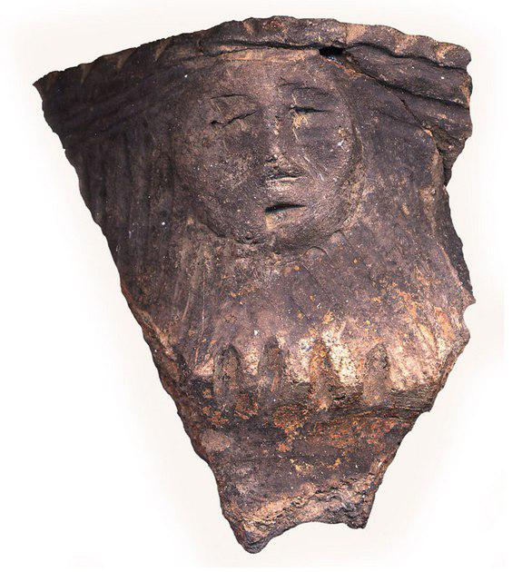 A human face effigy from ceramic vessel from the Mantle site. Credit: Image with permission of Archaeological Services Inc. Photo by Andrea Carnevale