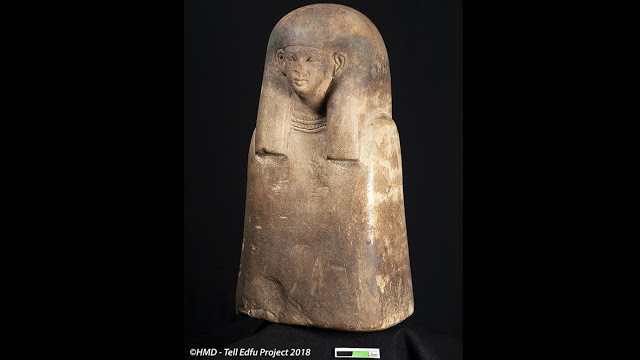 Bust of a female ancestor found on the floor of the domestic sanctuary. She wears a long tripartite wig  and a broad necklace called a wesekh collar. Credit: GM and HMD - Tell Edfu Project 2018.