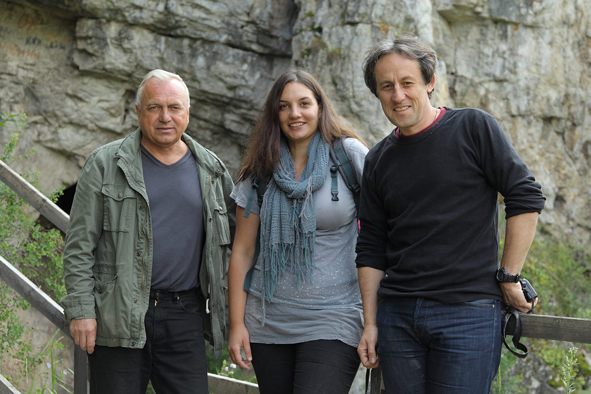 At the entrance of Denisova cave (left to right), excavation director Michael Shunkov, Katerina Douka, Tom Higham (photo courtesy and copyright Sergey Zelinski, Russian Academy of Sciences).