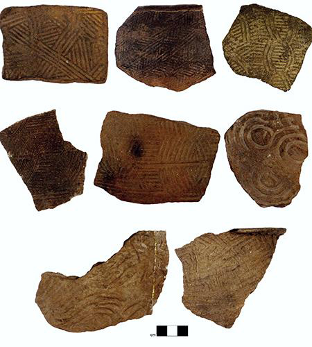 Examples of the kinds of pottery produced by people living across southern Appalachia between AD 800 and 1650. The unique symbols were stamped onto the pottery when the clay was still wet using carved wooden paddles. Credit: Jacob Lulewicz